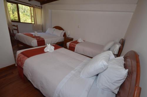A bed or beds in a room at Munay Punku
