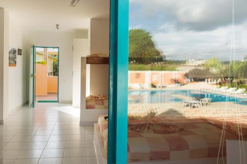 Vista de la piscina de Hotel Carluz o alrededores
