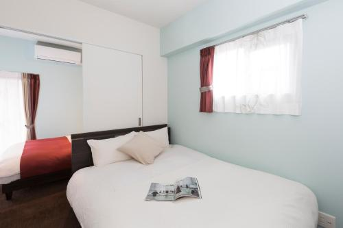 A bed or beds in a room at Residence Hotel Hakata 13