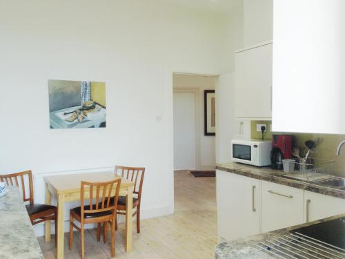 A kitchen or kitchenette at flat with lovely views