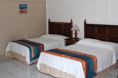 Cama o camas de una habitación en Hotel Mayto