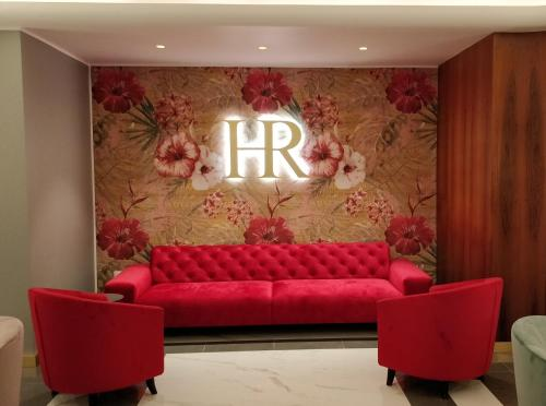 The lobby or reception area at Hotel Roma