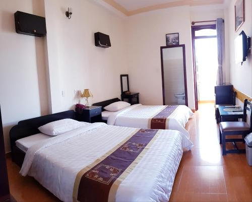 A bed or beds in a room at Villa Pink House