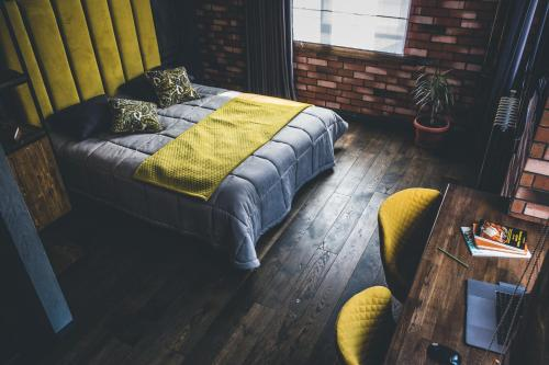 A bed or beds in a room at Secret Apartments of VL