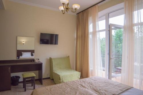 A bed or beds in a room at Troya Mini-hotel