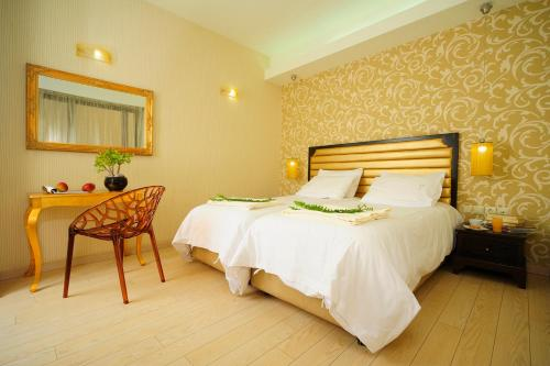 A bed or beds in a room at Steris Elegant Beach Hotel & Apartments