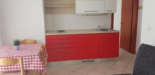 A kitchen or kitchenette at Apartments Biba