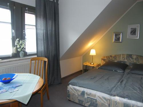 A bed or beds in a room at Domblick