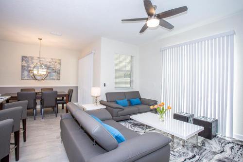 A seating area at Marvelous 4 Bedroom w/ Screened Pool Close to Disney 4977