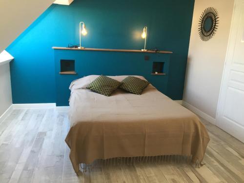 Un ou plusieurs lits dans un hébergement de l'établissement La Petite Mer