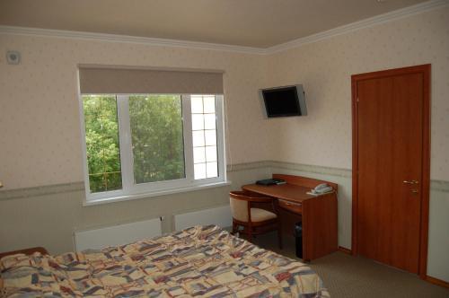 Кровать или кровати в номере Отель Митос