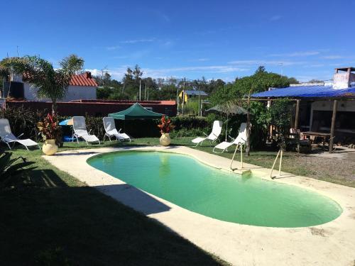 The swimming pool at or near Posada Escalones