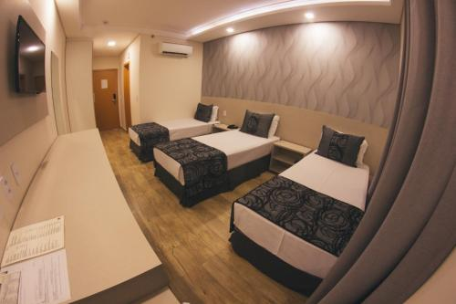 A bed or beds in a room at Summit GranVale Hotel