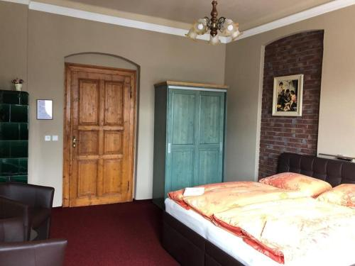 A bed or beds in a room at Pension Ulrika