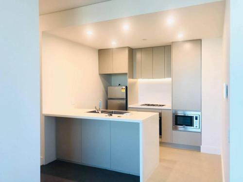 A kitchen or kitchenette at Perfect location for events@Sydney Olympic Park