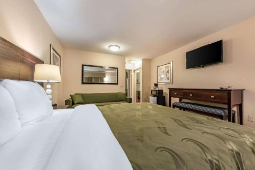 A bed or beds in a room at Quality Inn Monterey