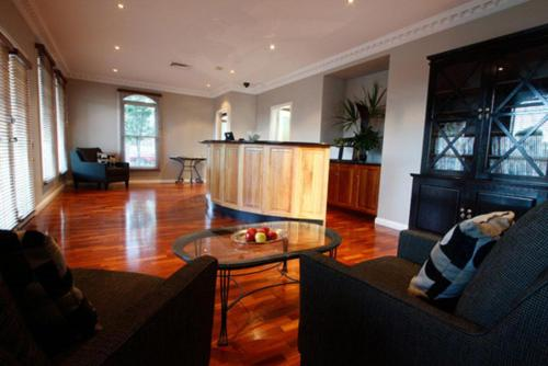 The lobby or reception area at Carlyle Suites & Apartments