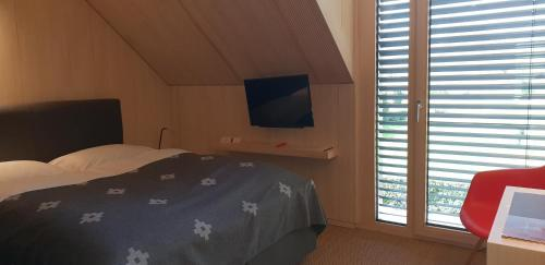 Ein Bett oder Betten in einem Zimmer der Unterkunft Schloss Auel Boutique Hotel