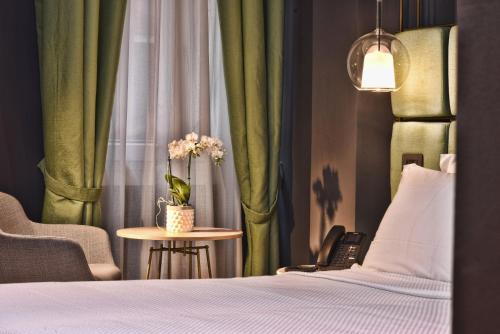 Un ou plusieurs lits dans un hébergement de l'établissement Hotel Maison Ducal
