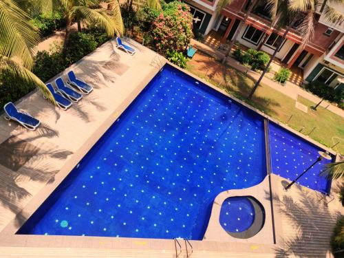 A view of the pool at Goa Chillout Apartment - 1BHK or nearby