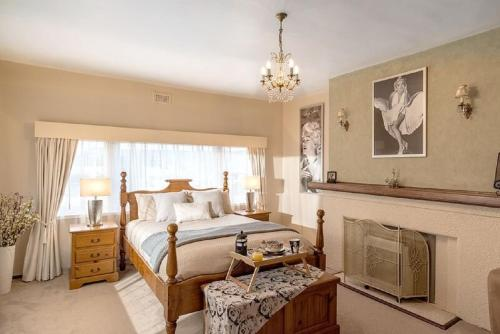 A bed or beds in a room at Jones On Wilson Boutique B&B