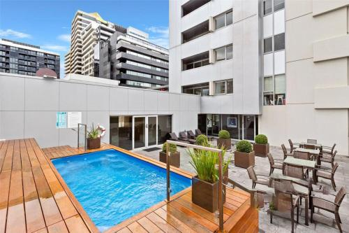 The swimming pool at or near Casey, South Yarra Private Apartments