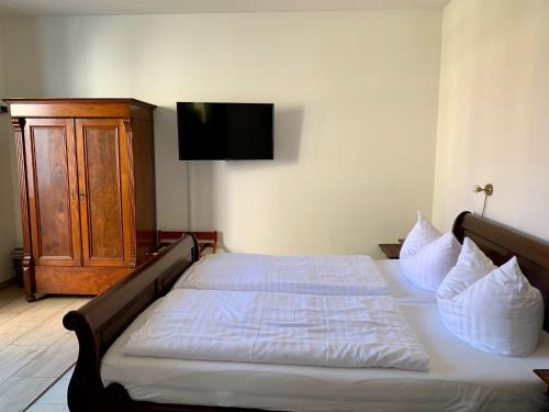 Ein Bett oder Betten in einem Zimmer der Unterkunft Luisenhof