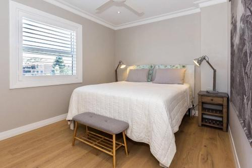 A bed or beds in a room at BONDI BREEZE-hosted by:L'Abode Accommodation