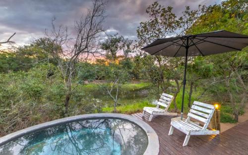 The swimming pool at or near Ngama Tented Safari Lodge