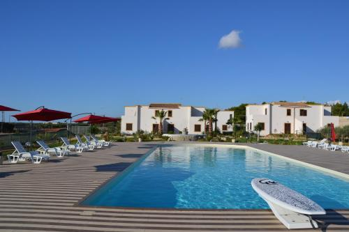 The swimming pool at or near Case Vacanza Torre Lupa