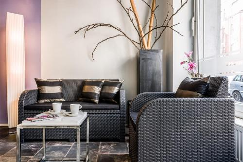 A seating area at Hotel 1A Apartment Berlin