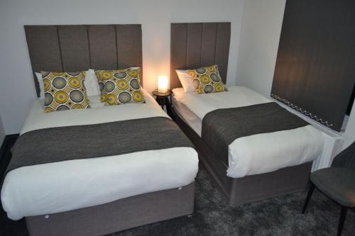 A bed or beds in a room at Manor House London