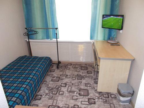 Кровать или кровати в номере Пара Тапок