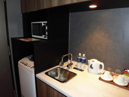A kitchen or kitchenette at Futakotamagawa Excel Hotel Tokyu