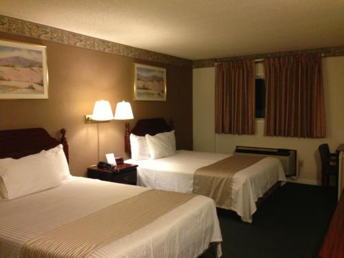 A bed or beds in a room at Americas Best Value Inn Macomb