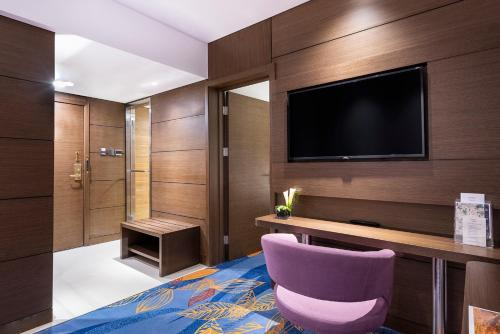 A television and/or entertainment center at Novotel Beijing Peace