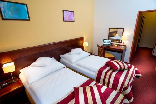 Un ou plusieurs lits dans un hébergement de l'établissement Hotel Petr
