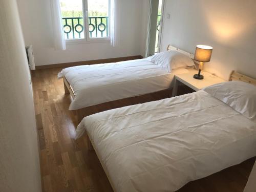 Un ou plusieurs lits dans un hébergement de l'établissement La Pommeray Geneva