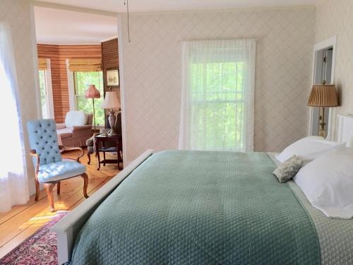 A bed or beds in a room at Victorian by the Sea