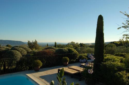 The swimming pool at or near Mas de la Beaume
