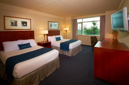 A bed or beds in a room at The Penn Stater Hotel and Conference Center