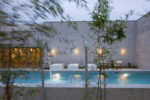 The swimming pool at or near Hotel Wu Wei