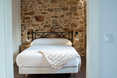 Cama o camas de una habitación en Casa Rural Liñeiros