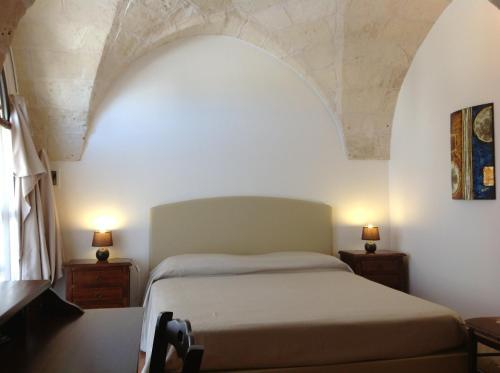Letto o letti in una camera di Masseria La Porticella