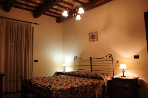 A bed or beds in a room at Il Casale