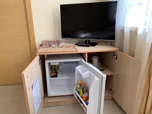 Телевизор и/или развлекательный центр в Макс Хаус