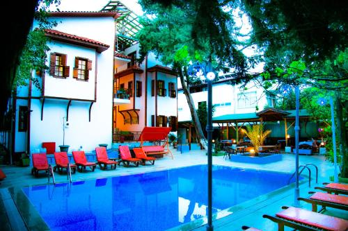The swimming pool at or near Kaliptus Hotel