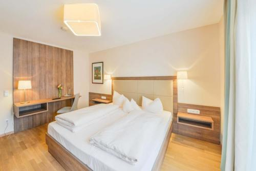 Ein Bett oder Betten in einem Zimmer der Unterkunft Der Kramerhof
