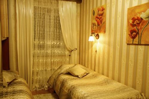 A bed or beds in a room at Rooms at Mayakovskaya