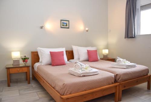 Ένα ή περισσότερα κρεβάτια σε δωμάτιο στο Atlantida Mare